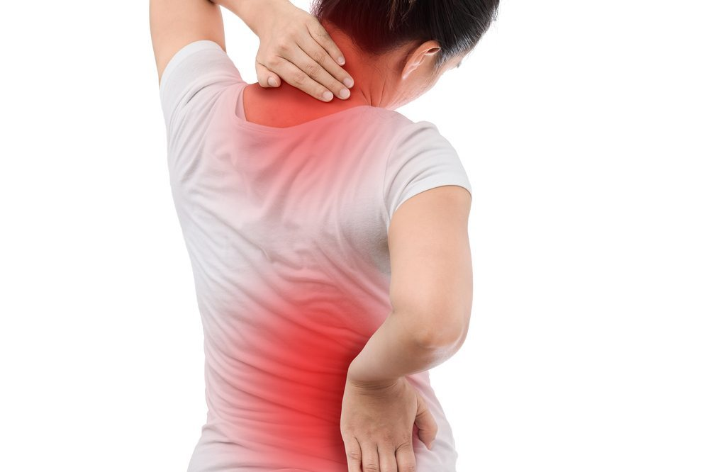 Woman experiencing back and neck pain from Systemic Lupus Erythematosus